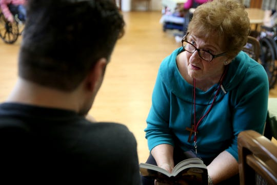 Volunteer Nadine Owings reads a book to a resident during a visit by the Friendship Brigade, a group of volunteers that focuses on spreading awareness about senior isolation and loneliness, at The Oaks at Sherwood Park in in Keizer on May 9, 2019.