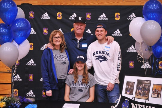 Salinas senior Savanna Maker (sitting) signs to play at the University of Nevada, Reno Thursday in front of her mother Stephanie (left), father Wyatt (middle) and brother Garrett (right).