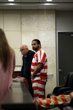 Angel Iniguez stands with his lawyer in court. May 9, 2019.