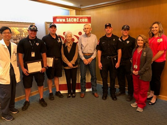 Five EMS workers were honored with the Lifesaver Award on Thursday, May 9, 2019, at San Angelo Community Medical Center. Pictured (from left to right) are: Dr. Jack Sun, Darin Wright, Ben Ashlock, patient Lessie Spieker and husband Eugene, Larry Hill, Ben Heinze, chest pain coordinator Kelli Hudson, and the Spiekers' granddaughter, Sarah Wilkes. McShane Matthews, who was among the five EMS workers honored, wasn't able to attend the event.