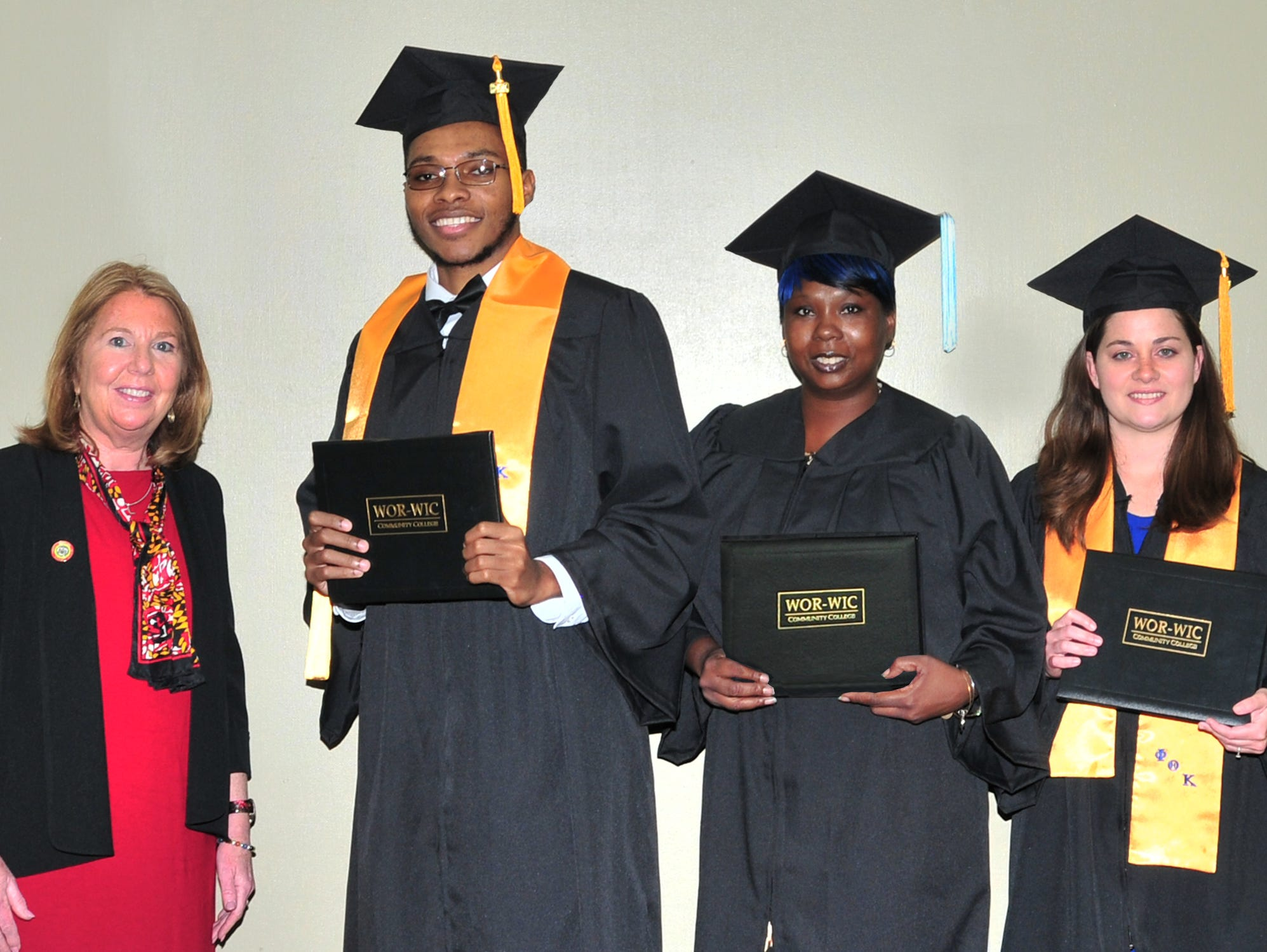 Sen. Mary Beth Carozza, R-38, of Ocean City, at left, congratulates some of the graduates from Somerset County who received their associate degrees at Wor-Wic Community College. From left, next to Carozza, are Deshawn Carr, Angela Whidbee, and Alison Shores.