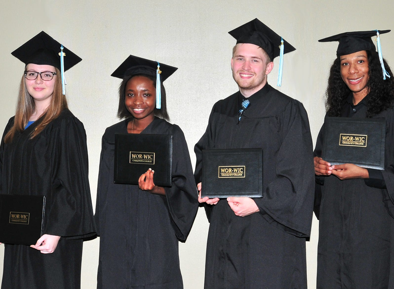 Del. Sheree Sample-Hughes, D-37A, of Salisbury, congratulates some of the graduates who received their associate degrees at Wor-Wic Community College. From left, next to Sample-Hughes, are Brooke Thomas, Jasmine Goslee, Cory Davis and James Crumpler.