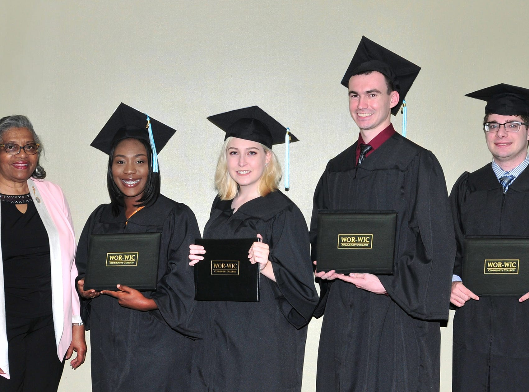 Diana Purnell of Berlin, president of the Worcester County Commissioners, congratulates some of the graduates from northern Worcester County who received their associate degrees at Wor-Wic Community College. From left, next to Purnell, Brianna Bowen, Jacqueline McGuire, Tyler Tull and Mitchell Cooper of Bishopville.