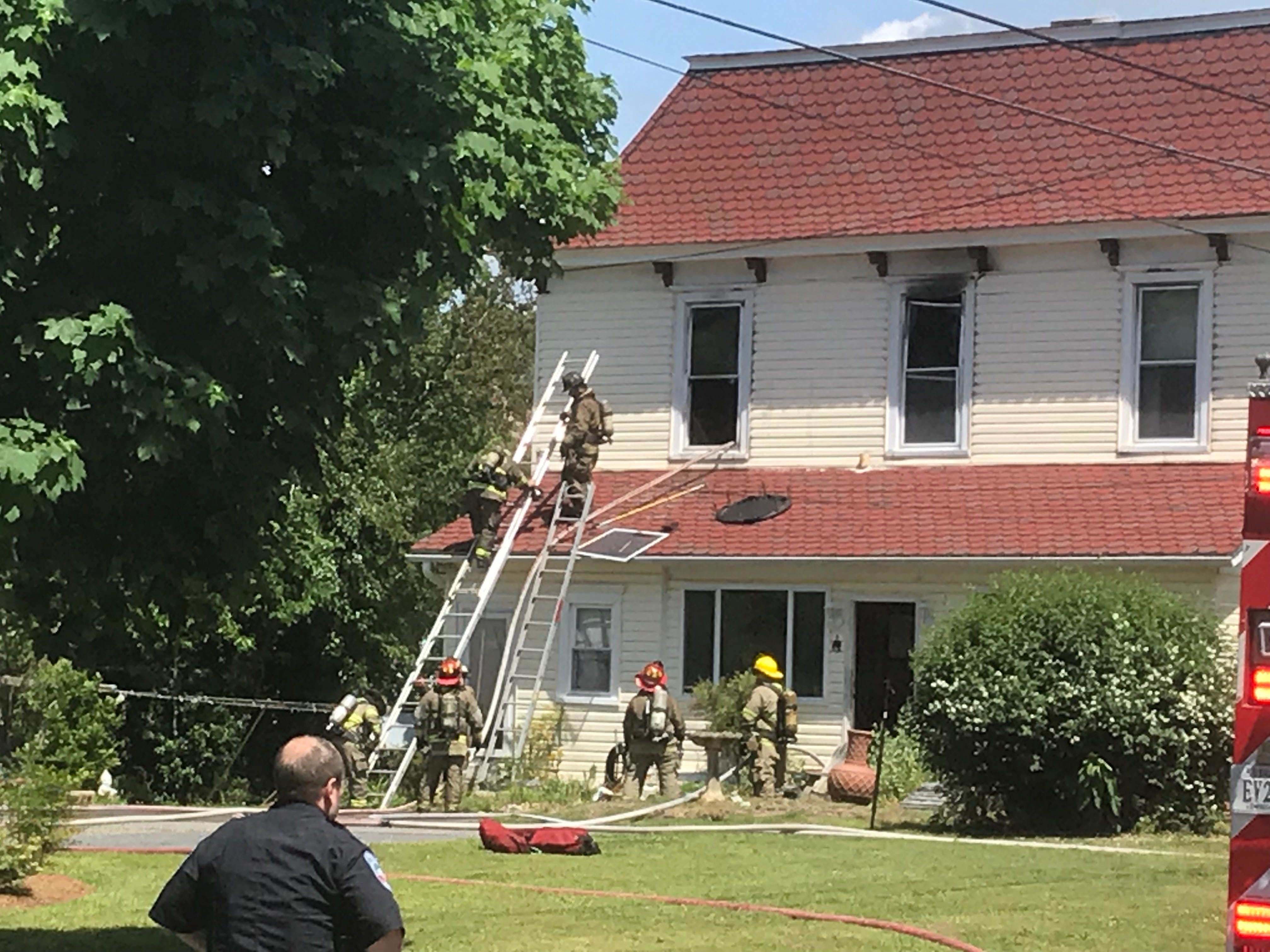Firefighters battle a house fire at 2 Holly Street in Onancock, Virginia on Thursday, May 9, 2019.