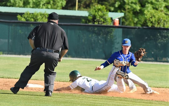 Parkside High School's Derek Frisch slides into second base against Wi-Hi in the first round of the state tournament on Thursday, May 9, 2019.
