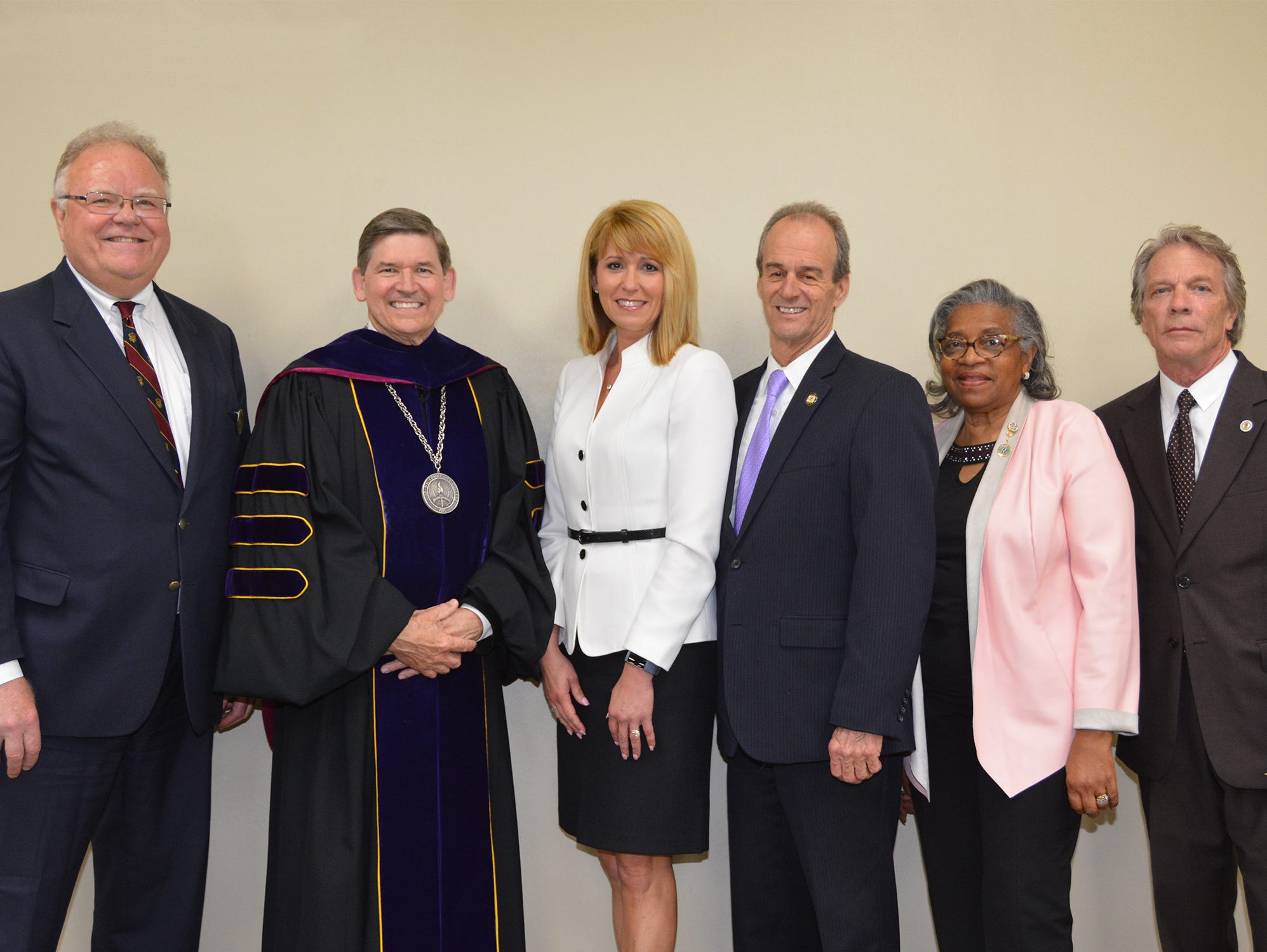 Officials on stage for Wor-Wic Community College commencement, from left, Martin T. Neat of Salisbury, chairperson of the board of trustees at Wor-Wic; Dr. Ray Hoy of Salisbury, president of the college; Kelly M. Schulz, secretary of the Maryland Department of Commerce, who was the commencement speaker; Wicomico County Executive Bob Culver of Salisbury; Diana Purnell of Berlin, president of the Worcester County Commissioners; and John Cannon of Salisbury, president of the Wicomico County Council.