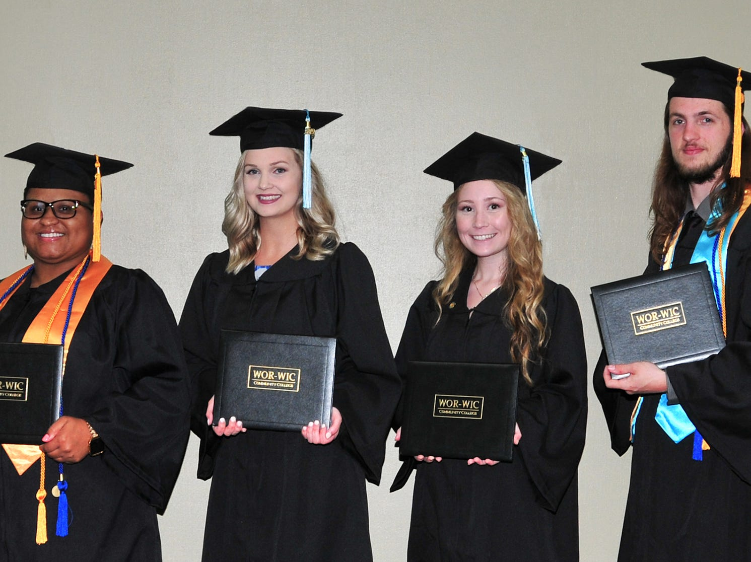 Russell W. Blake of Pocomoke City, vice chairman of the board of trustees at Wor-Wic Community College, congratulates some of the graduates from southern Worcester County who received their associate degrees. From left, next to Blake, are April Powell, Madison Parks, Rachel Richardson and Mitchell Krystoflak.