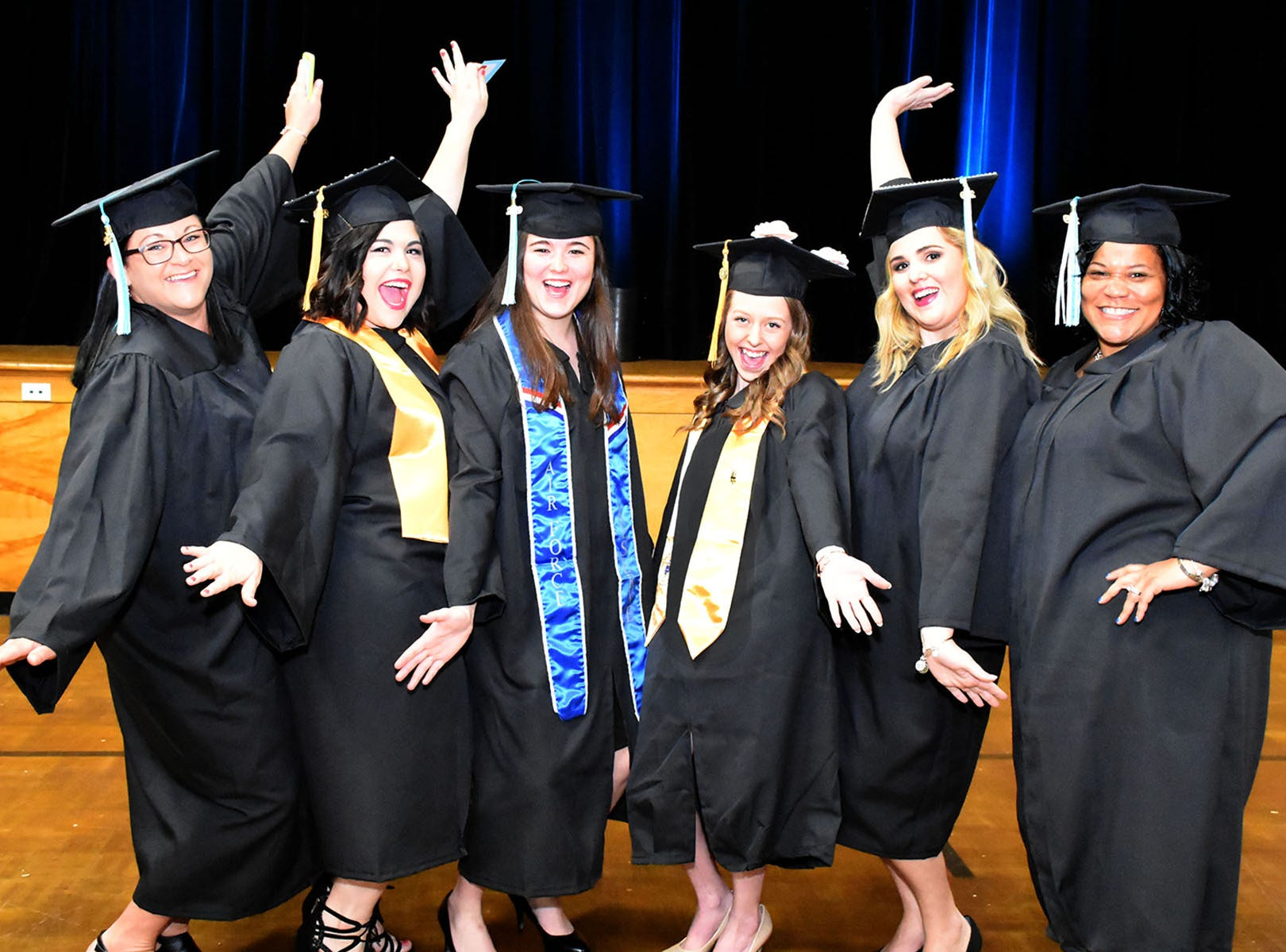 Graduates celebrate after the Wor-Wic Community College commencement exercises at the Wicomico Youth and Civic Center.