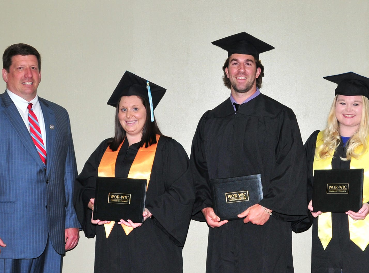 Del. Wayne Hartman, R-38C, of Ocean City, congratulates some of the graduates from Ocean City who received their associate degrees at Wor-Wic Community College. From left, next to Hartman, Lindsey Moore, Gavin Aquino, Tiffany Hastings, and Ryan Jasinski.