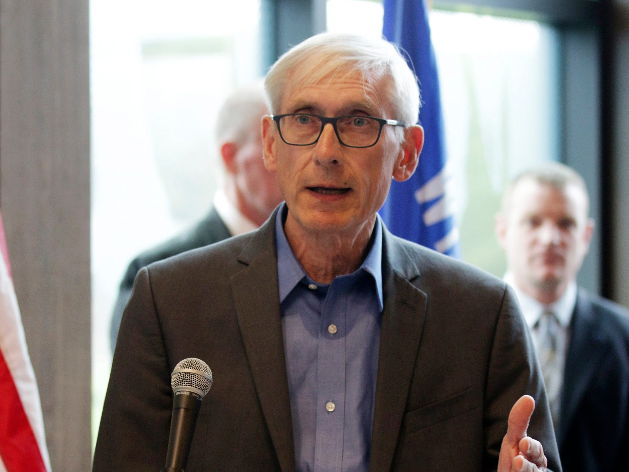 Gov. Tony Evers gestures while speaking at the state Highway 23 four-lane expansion groundbreaking, Wednesday, May 8, 2019, at the Wade House in Greenbush, Wis.  Officials said that the construction would start May 13, 2019.