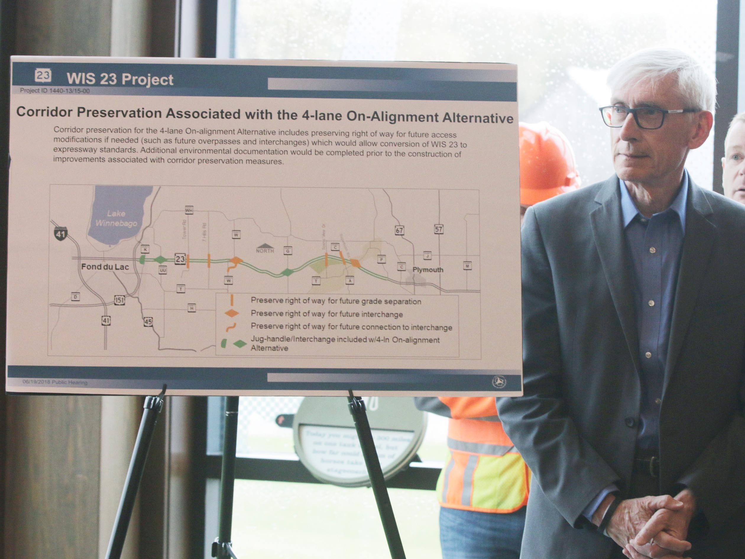 Gov. Tony Evers stands by a mape of the  state Highway 23 four-lane expansion project at its groundbreaking, Wednesday, May 8, 2019, at the Wade House in Greenbush, Wis.  Officials said that the construction would start May 13, 2019.