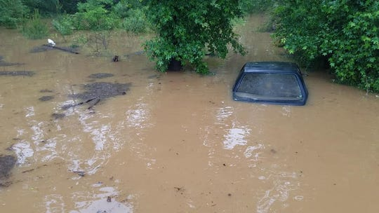 A car is submerged under water at an area near Cannon Road in Bossier Parish on May 9, 2019.