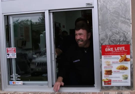 Chuck Norris poses in the drive-thru at Raising Cane's in Houston.