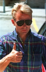 Butch Oseby gives a thumbs-up sign as he enters the federal courthouse in Sioux Falls in 1999. He was charged with fraud and bribery in connection with the illegal sale of surplus property.