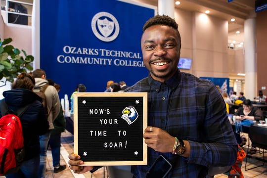 Igho Ekakitie, a student at Ozarks Technical Community College, holds a sign with an OTC motto.