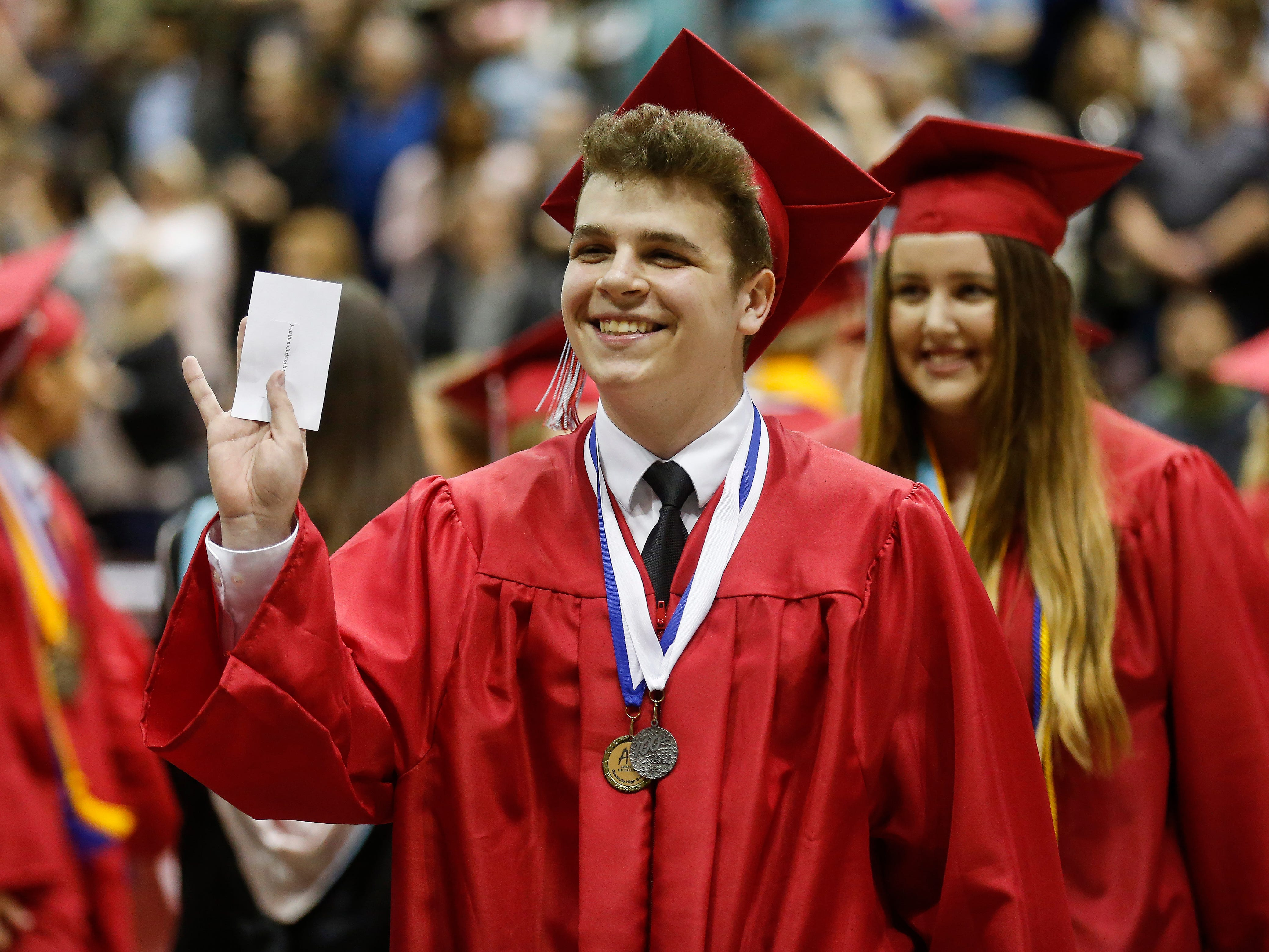Class President Jonathan Ivanoff waves during Glendale High School's Commencement Ceremony at JQH Arena on Thursday, May 9, 2019.
