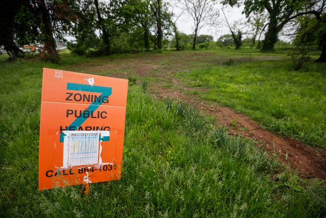"""Eden Village II supporters areasking the council to rezone the five acres at 3303 W. Division St., from a Light Industrial District to a Commercial Service District, which would allow for an """"RV park"""" of 40 tiny manufactured homes."""