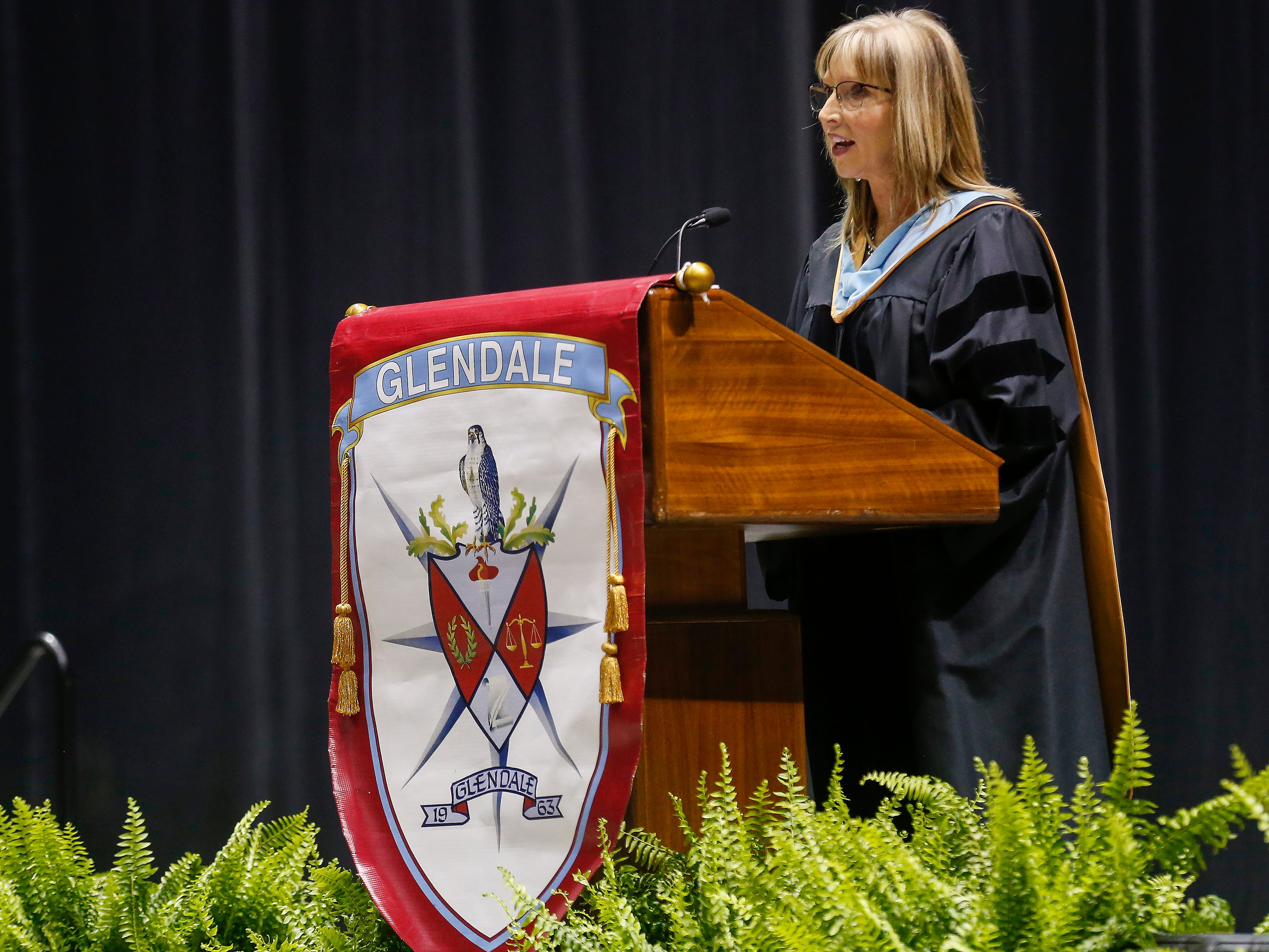 Principal Natalie Cauldwell speaks during Glendale High School's Commencement Ceremony at JQH Arena on Thursday, May 9, 2019.