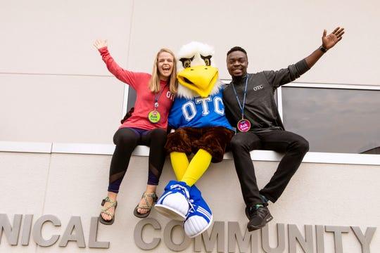 Igho Ekakitie with the OTC mascot