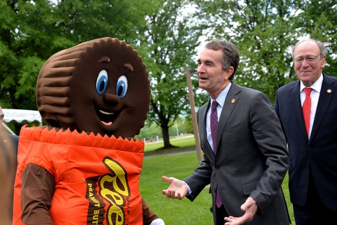 Gov. Ralph Northam with one of the Hershey Chocolate mascots during an economic development announce May 9, 2019.