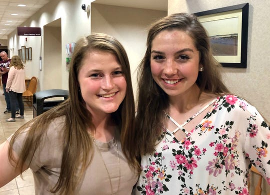 Fort Defiance freshmen Lilian Berry (left) and Courtney Begoon spoke Wednesday night to the Augusta County Board of Supervisors about the need for lights on softball fields.