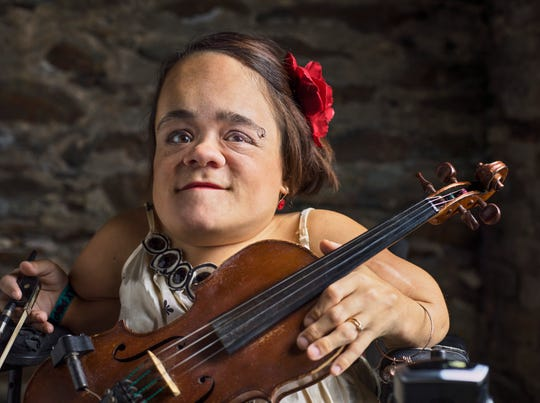 Gaelynn Lea poses with her violin, which she plays upright like a cello. She will play Jules' Bistro in downtown St. Cloud on Tuesday, May 21.