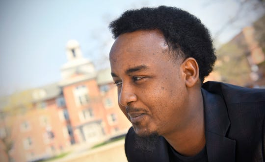 Suud Olat pauses while talking about his plans for the future during an interview Tuesday, May 7, at St. Cloud State University. Olat will graduate Friday with a degree in international relations.
