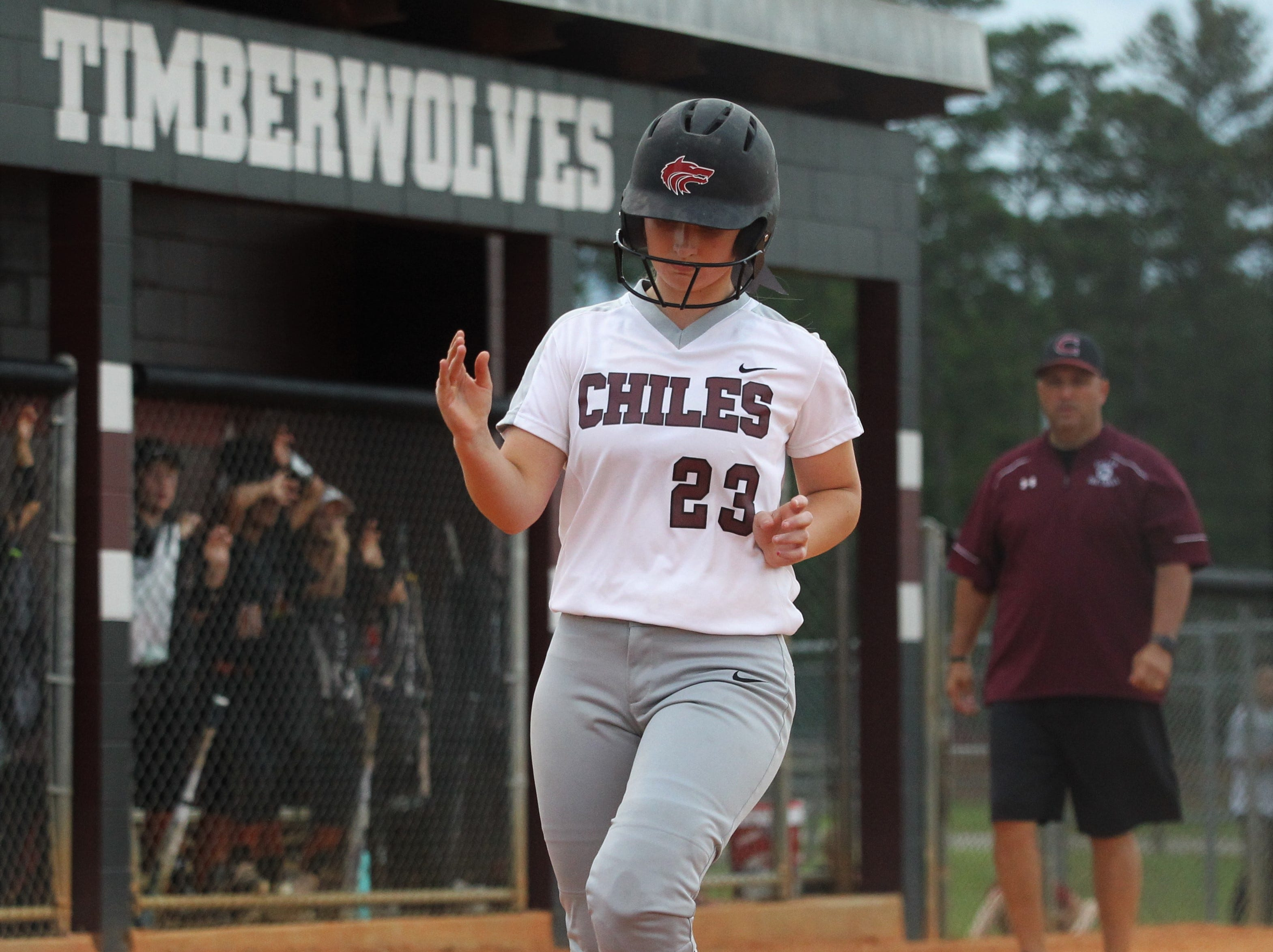 Chiles junior Sierra Jevyak scores a first-inning run as the Timberwolves beat Atlantic Coast 6-4 during a Region 1-8A quarterfinal softball game on Wednesday, May 8, 2019.