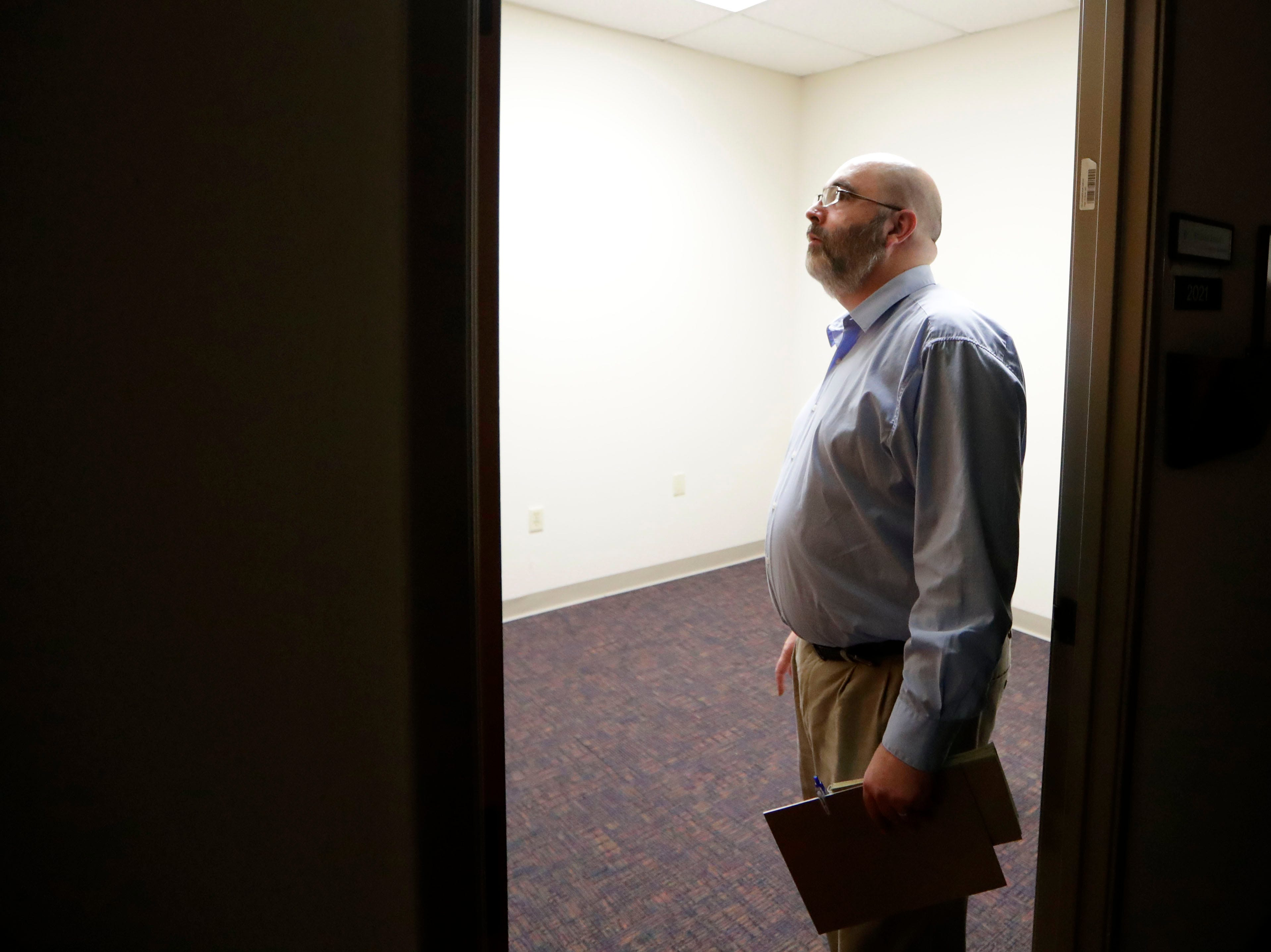 Robert Culverhouse, who works with the city's real estate department, looks at a vacant office inside the Norhtwood Centre Wednesday, May 8, 2019.