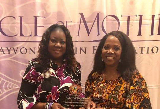 Sybrina Fulton with Rosalind Tompkins presenting HOPEE award.