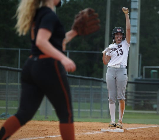 Chiles senior Kelsey Mead reacts to hitting a three-run triple in the first inning as the Timberwolves beat Atlantic Coast 6-4 during a Region 1-8A quarterfinal softball game on Wednesday, May 8, 2019.