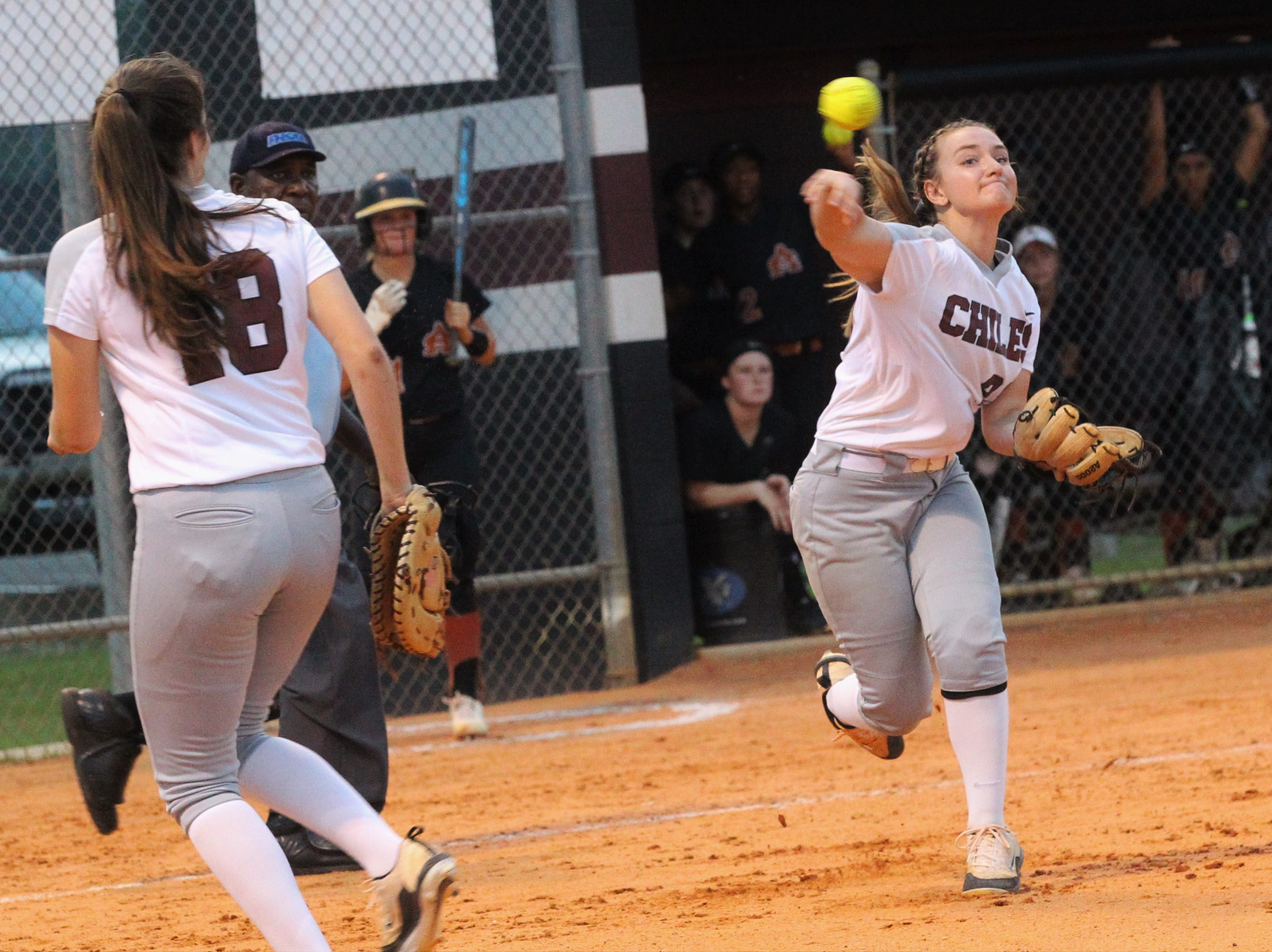Chiles third baseman Sierra Jevyak throws to first as the Timberwolves beat Atlantic Coast 6-4 during a Region 1-8A quarterfinal softball game on Wednesday, May 8, 2019.