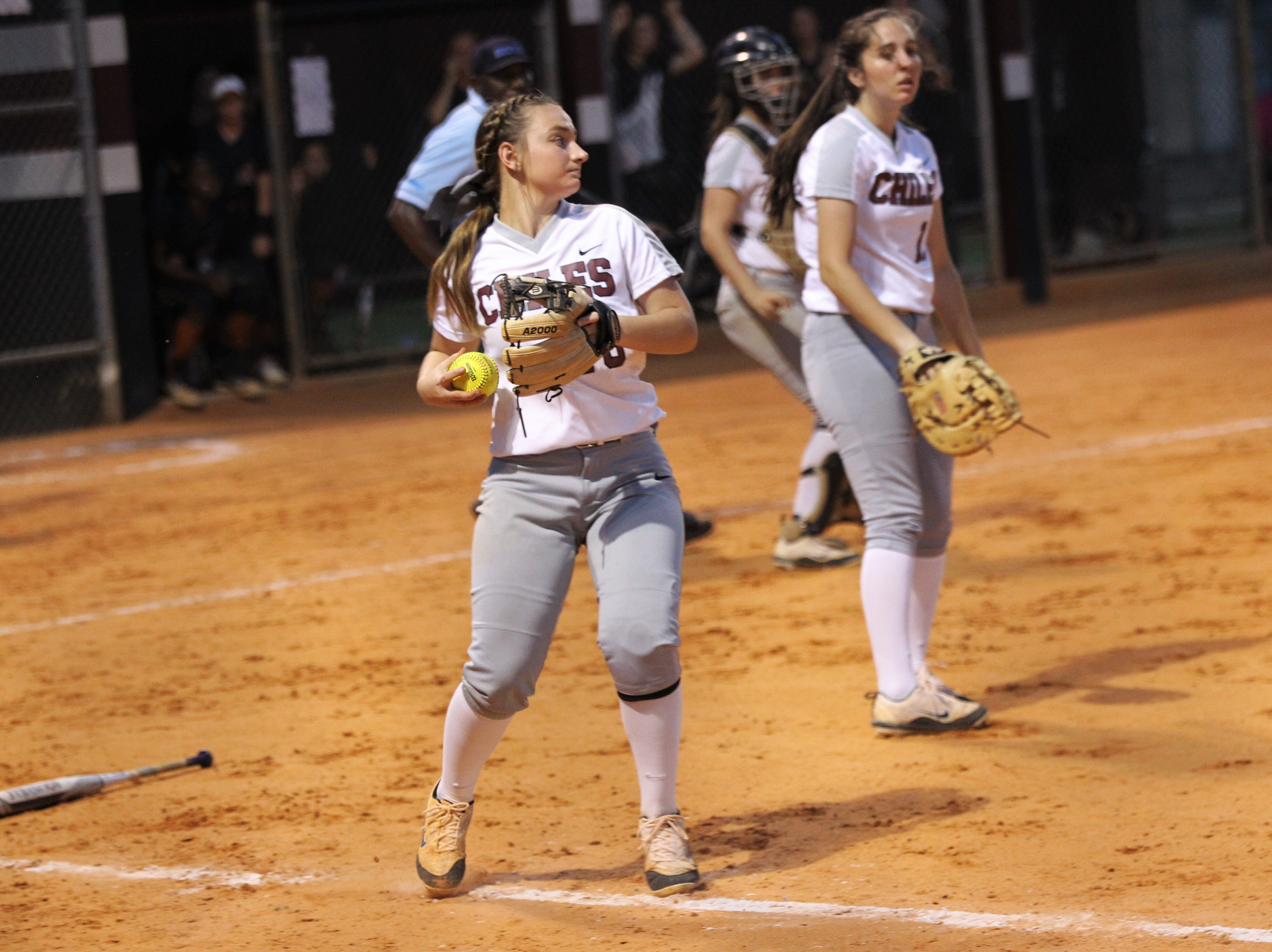 Chiles third baseman Sierra Jevyak fields a bunt but no play can be made as the Timberwolves beat Atlantic Coast 6-4 during a Region 1-8A quarterfinal softball game on Wednesday, May 8, 2019.