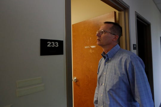 Wayne Tedder, assistant city manager, walks into a vacant office as he tours the Northwood Centre Wednesday, May 8, 2019.