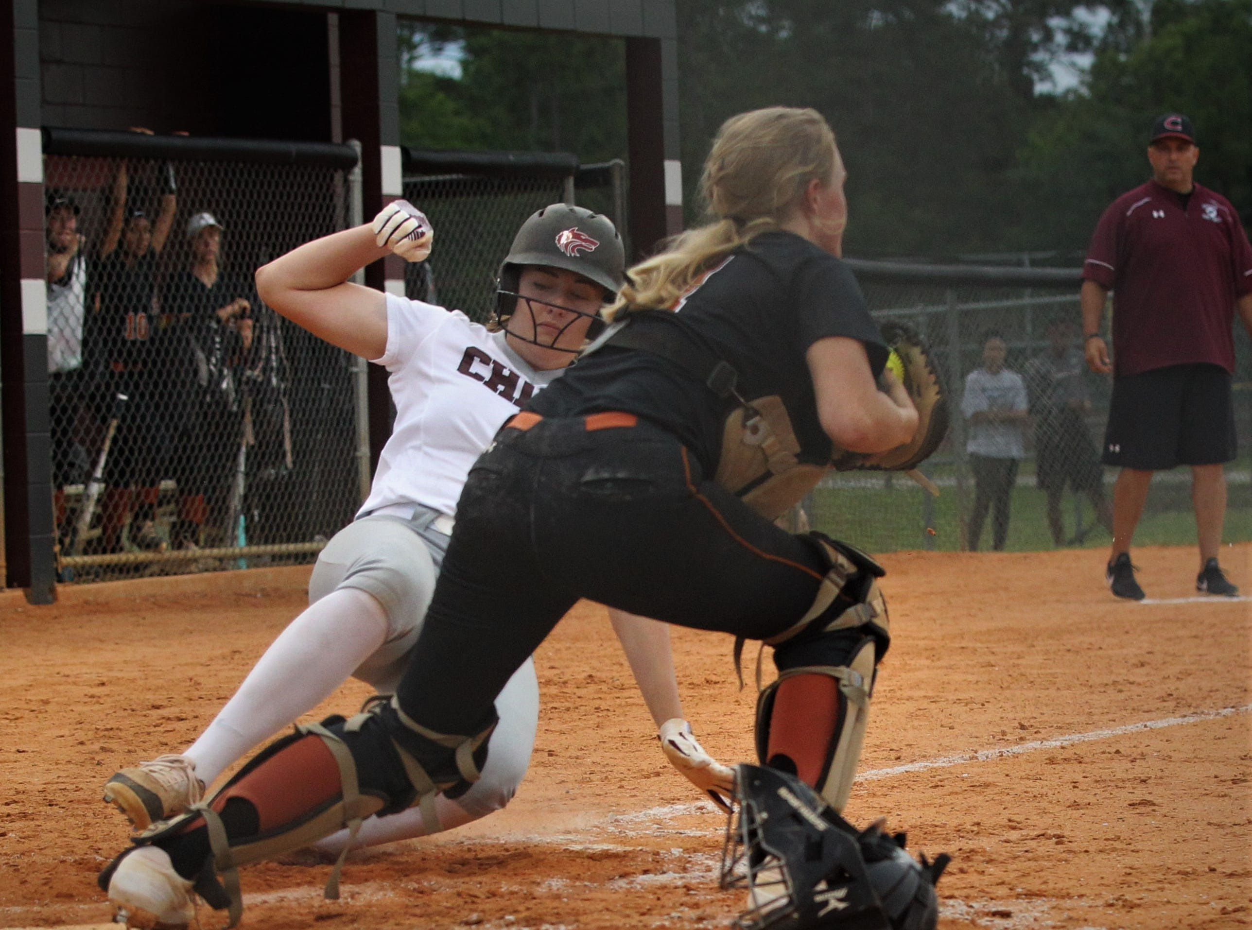 Chiles senior Haley Bond slides into home but a force out beats her as the Timberwolves beat Atlantic Coast 6-4 during a Region 1-8A quarterfinal softball game on Wednesday, May 8, 2019.