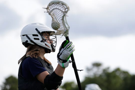 Kemp Peoples passes the ball during Tallahassee Terror lacrosse practice at The Farm Equestrian Center.