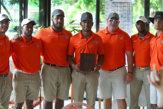 From left to right: Alejandro Toro, Mahindra Lutchman, Cameron Riley, Ethan Mangum, head coach Mike Rice, Mulbe Dillard IV and Logan Bryant represent FAMU golf.