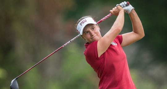 Florida State women's golfer Amanda Doherty completes a swing.