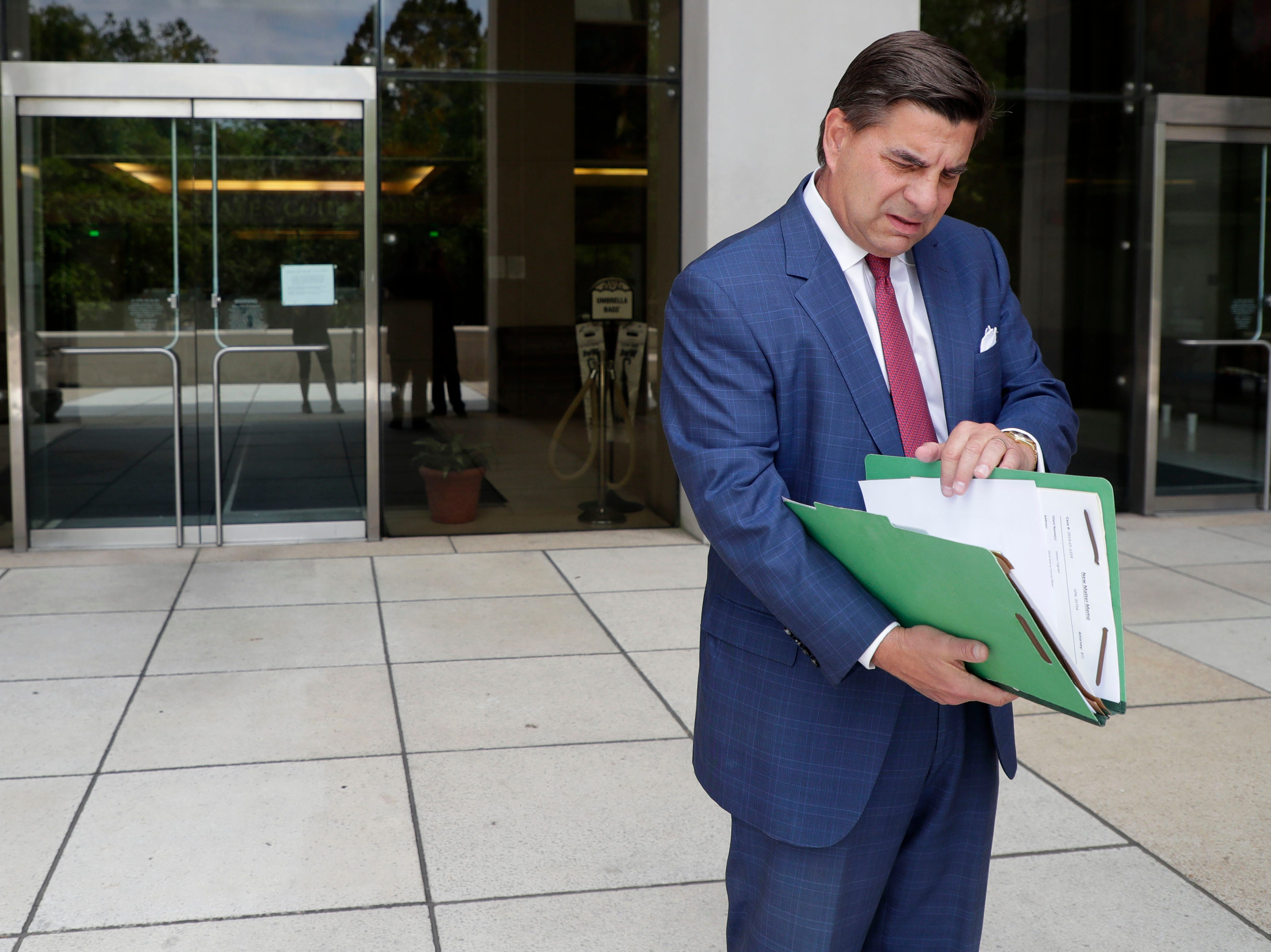 Tallahassee attorney Tim Jansen looks through his files as he speaks with the Tallahassee Democrat about J.T. Burnette's indictment in the FBI's long-running public corruption probe Thursday, May 9, 2019.