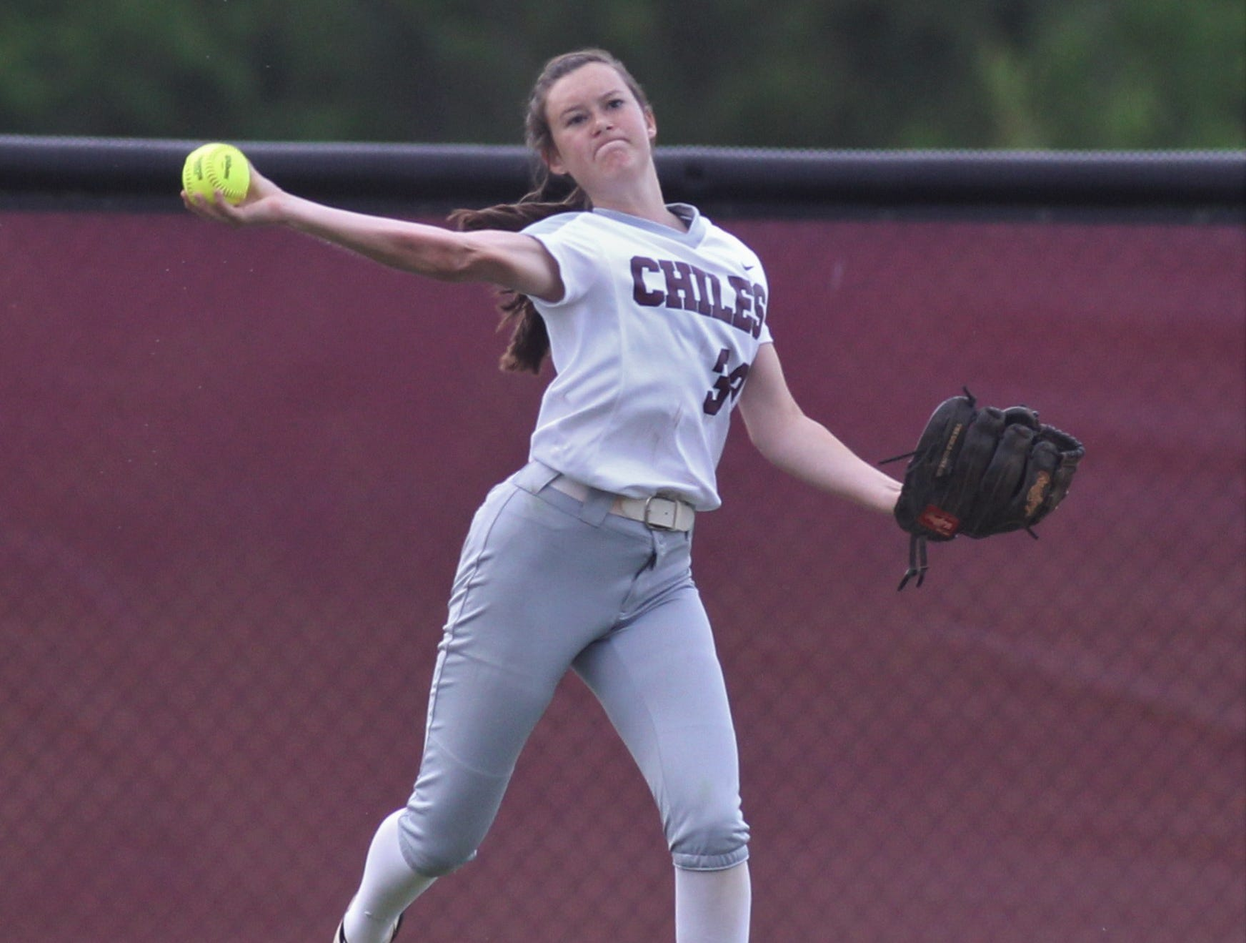 Chiles outfielder Meghan Lucas throws a back back to the infield as the Timberwolves beat Atlantic Coast 6-4 during a Region 1-8A quarterfinal softball game on Wednesday, May 8, 2019.
