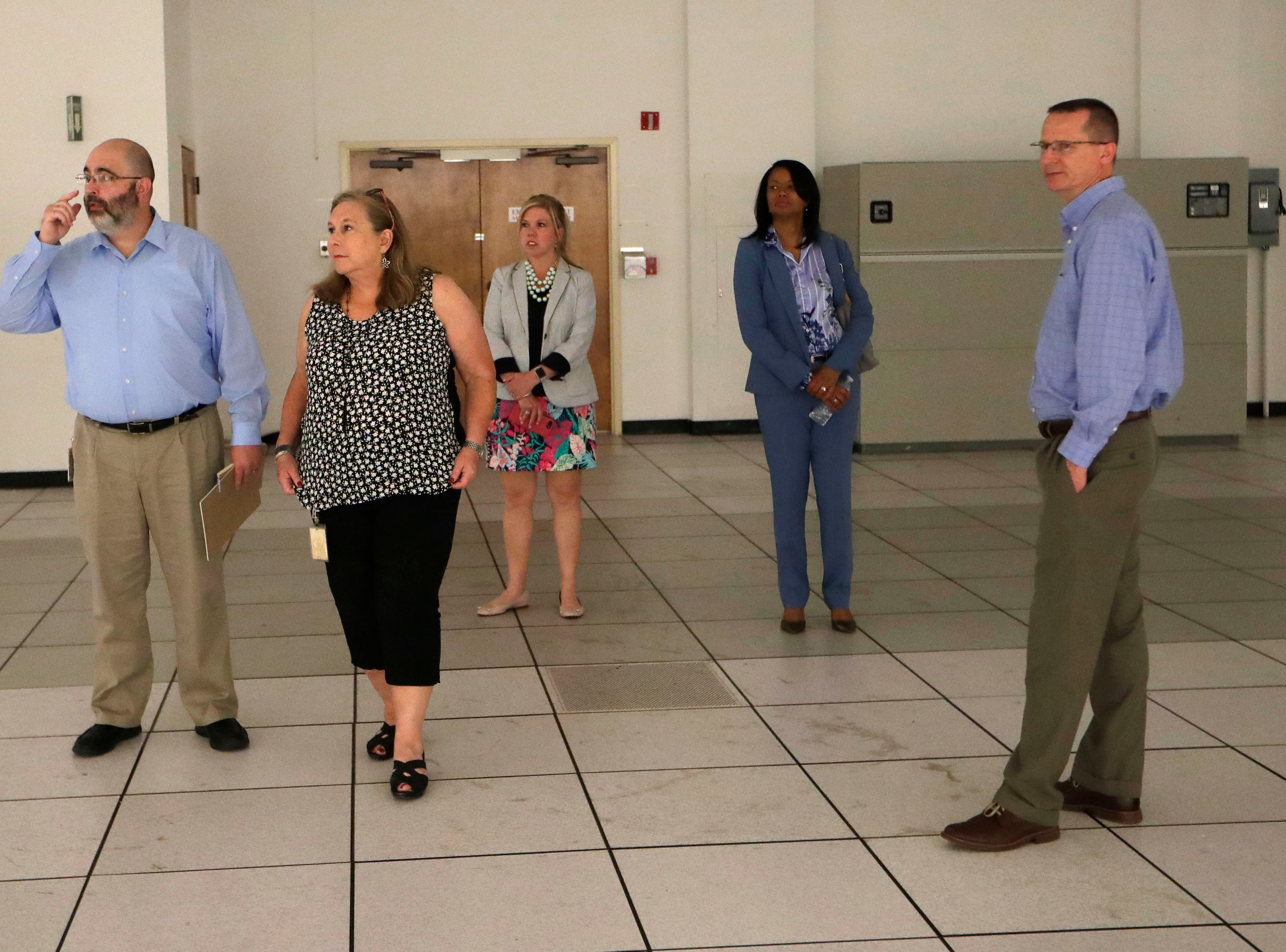 Robert Culverhouse, who works with the city's real estate department, left, Judy Donahue, who works with the city's real estate department, Alison Faris, director of communications for the city of Tallahassee, Cassandra Jackson, city attorney, and Wayne Tedder, assistant city manager, stand in a vacant office space during a tour of the Northwood Centre Wednesday, May 8, 2019.