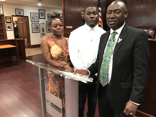 Jovan O'Neal (center) flanked by his mother, Quita Conyers, left, and attorney Ben Crump.