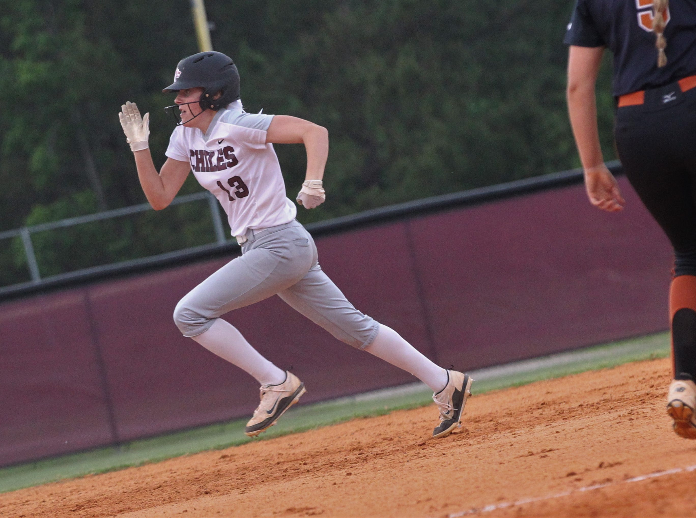 Chiles senior Kelsey Mead hits a three-run triple in the first inning as the Timberwolves beat Atlantic Coast 6-4 during a Region 1-8A quarterfinal softball game on Wednesday, May 8, 2019.