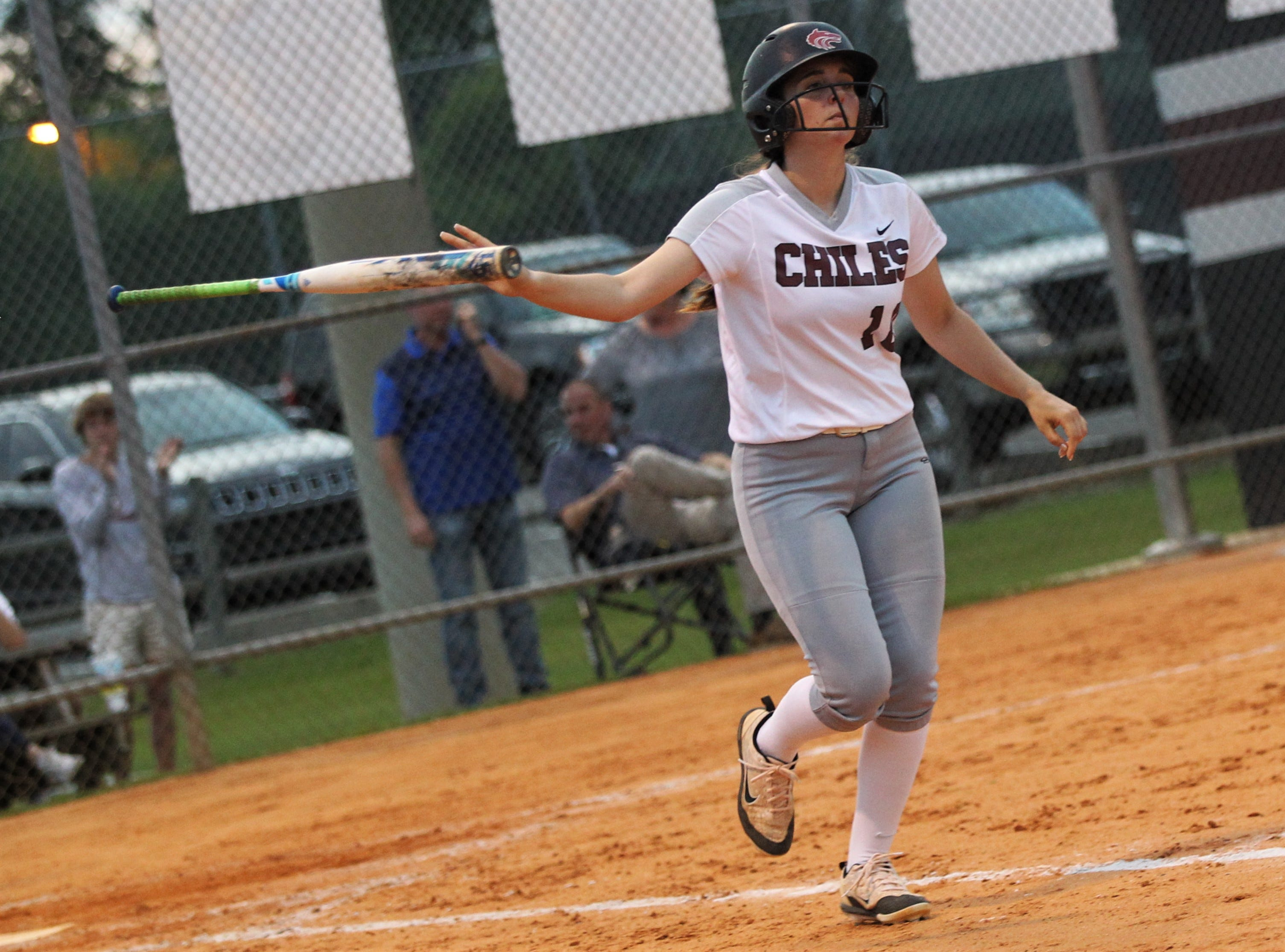 Chiles junior Megan Monk bat flips after a walk as the Timberwolves beat Atlantic Coast 6-4 during a Region 1-8A quarterfinal softball game on Wednesday, May 8, 2019.