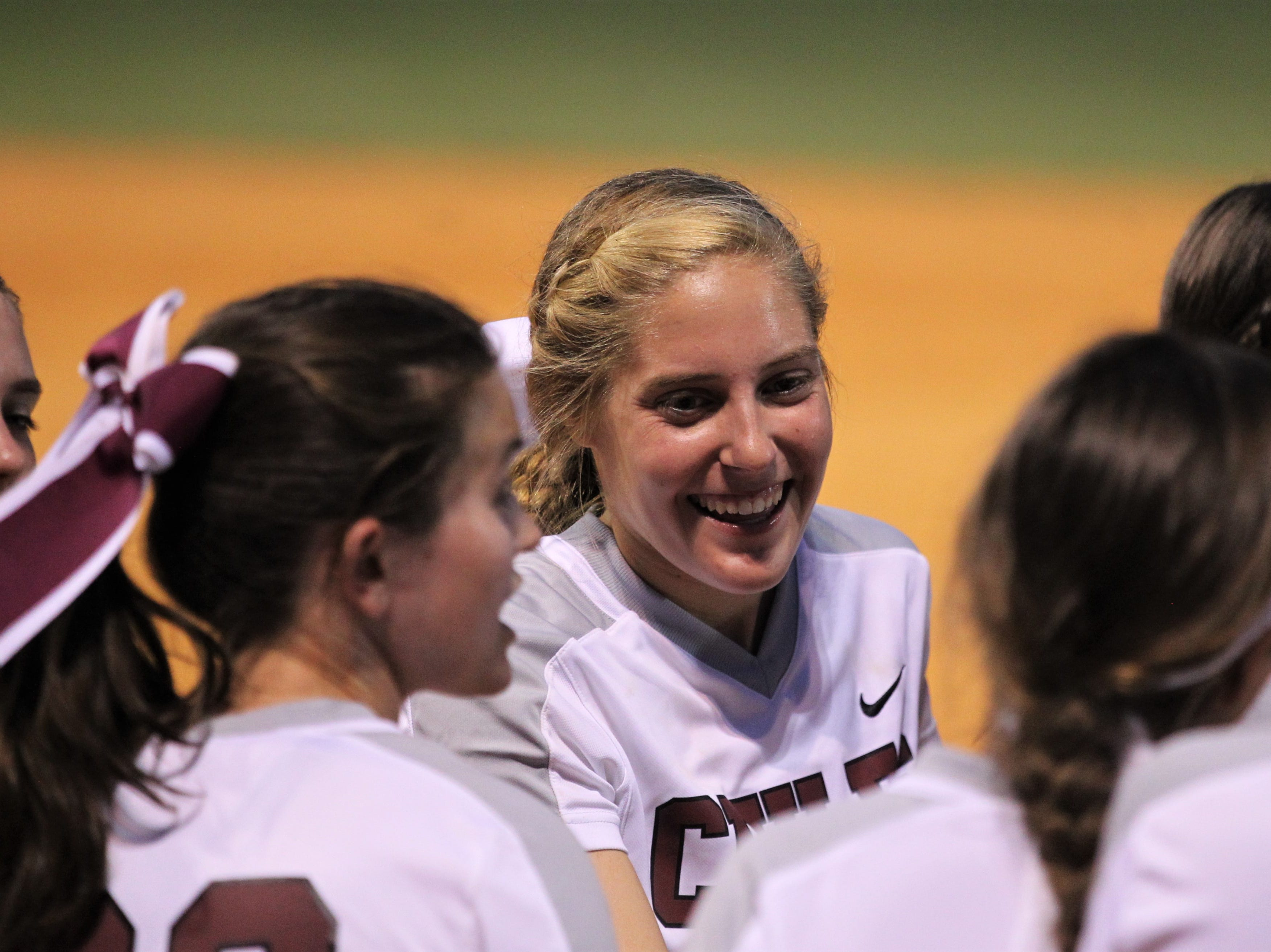 Chiles senior second baseman Kelsey Mead smiles after an inning as the Timberwolves beat Atlantic Coast 6-4 during a Region 1-8A quarterfinal softball game on Wednesday, May 8, 2019.
