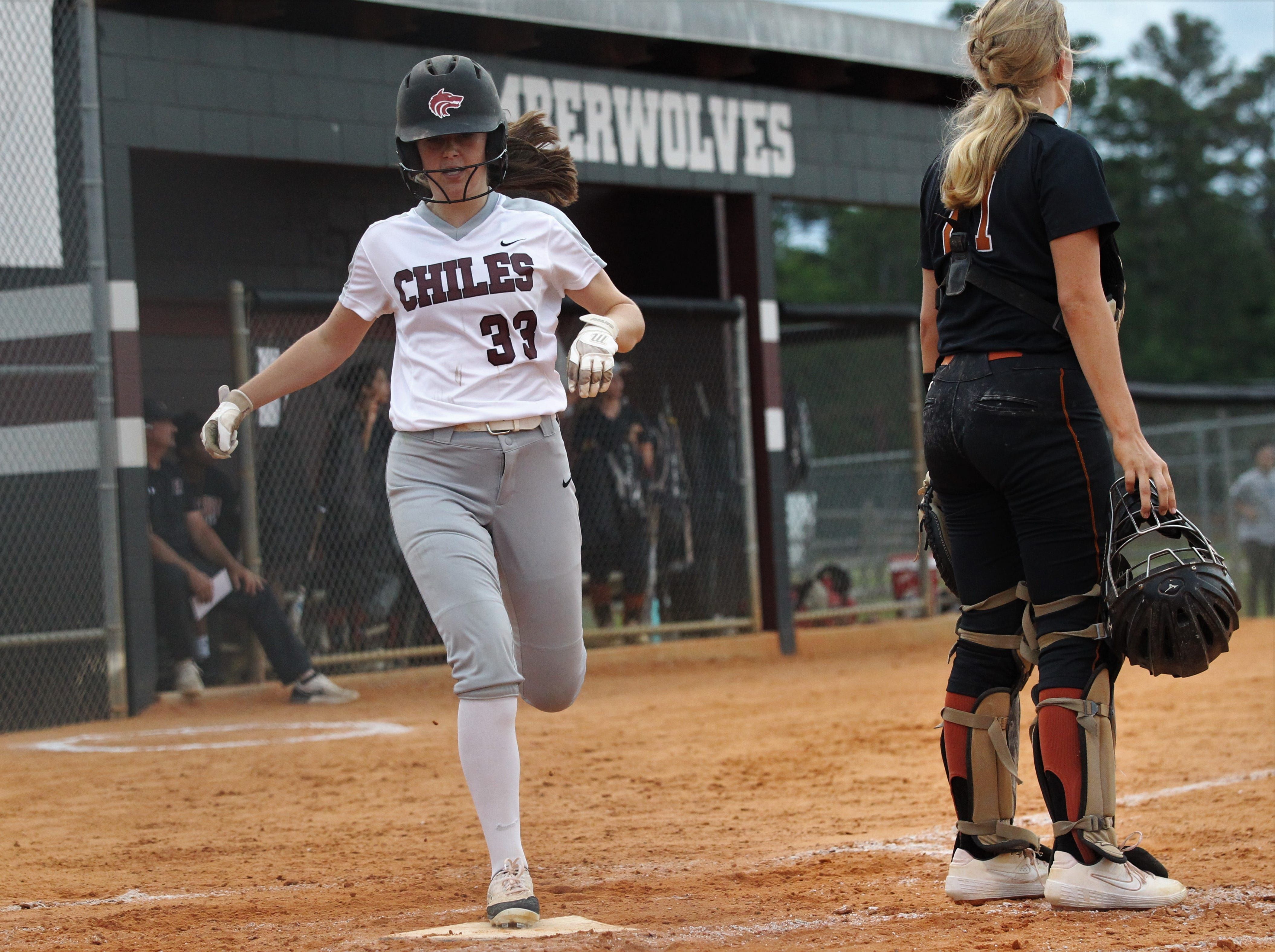 Chiles sophomore Meghan Lucas scores a run as the Timberwolves beat Atlantic Coast 6-4 during a Region 1-8A quarterfinal softball game on Wednesday, May 8, 2019.