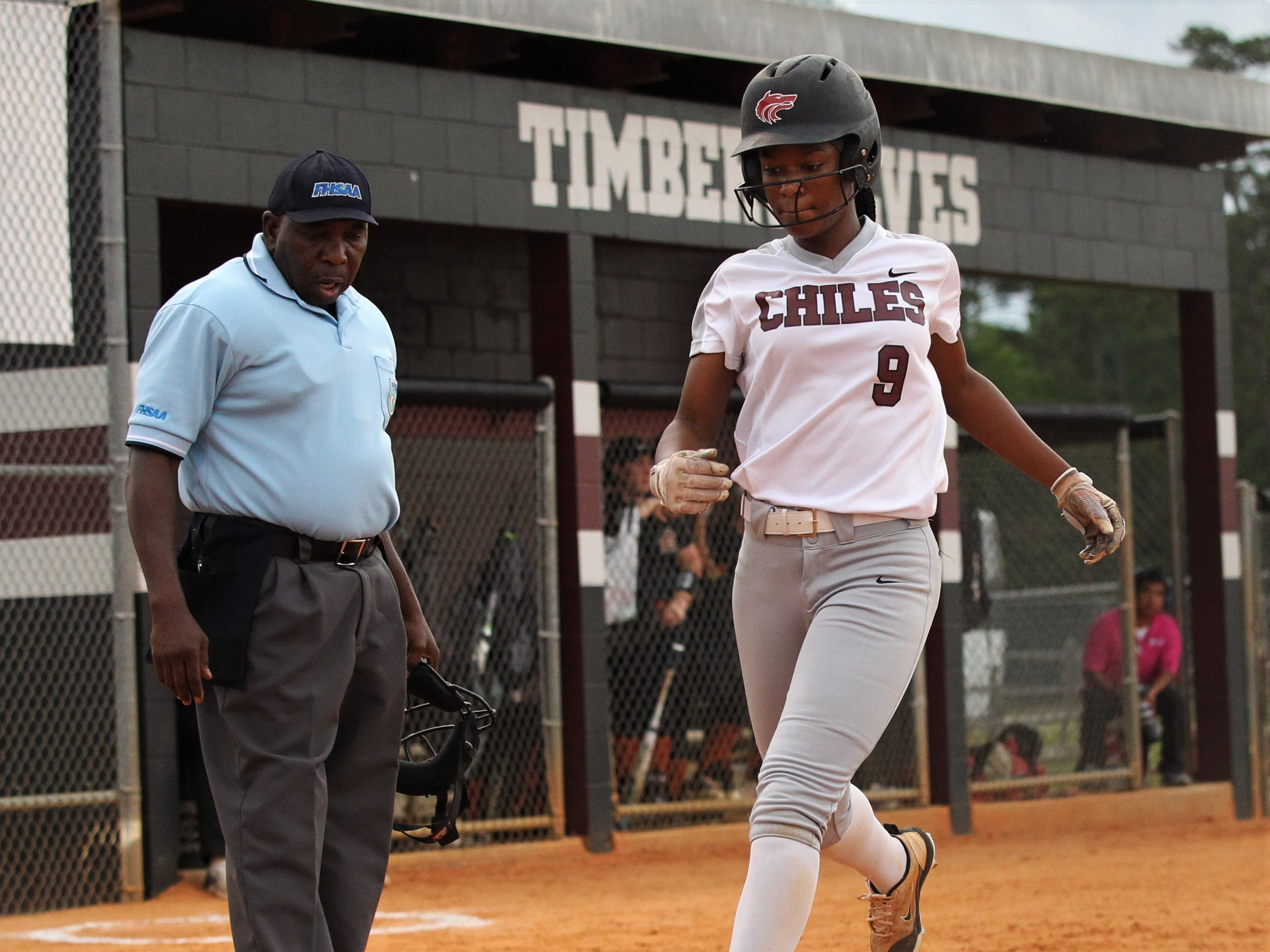 Chiles junior Lamari White scores a first-inning run as the Timberwolves beat Atlantic Coast 6-4 during a Region 1-8A quarterfinal softball game on Wednesday, May 8, 2019.