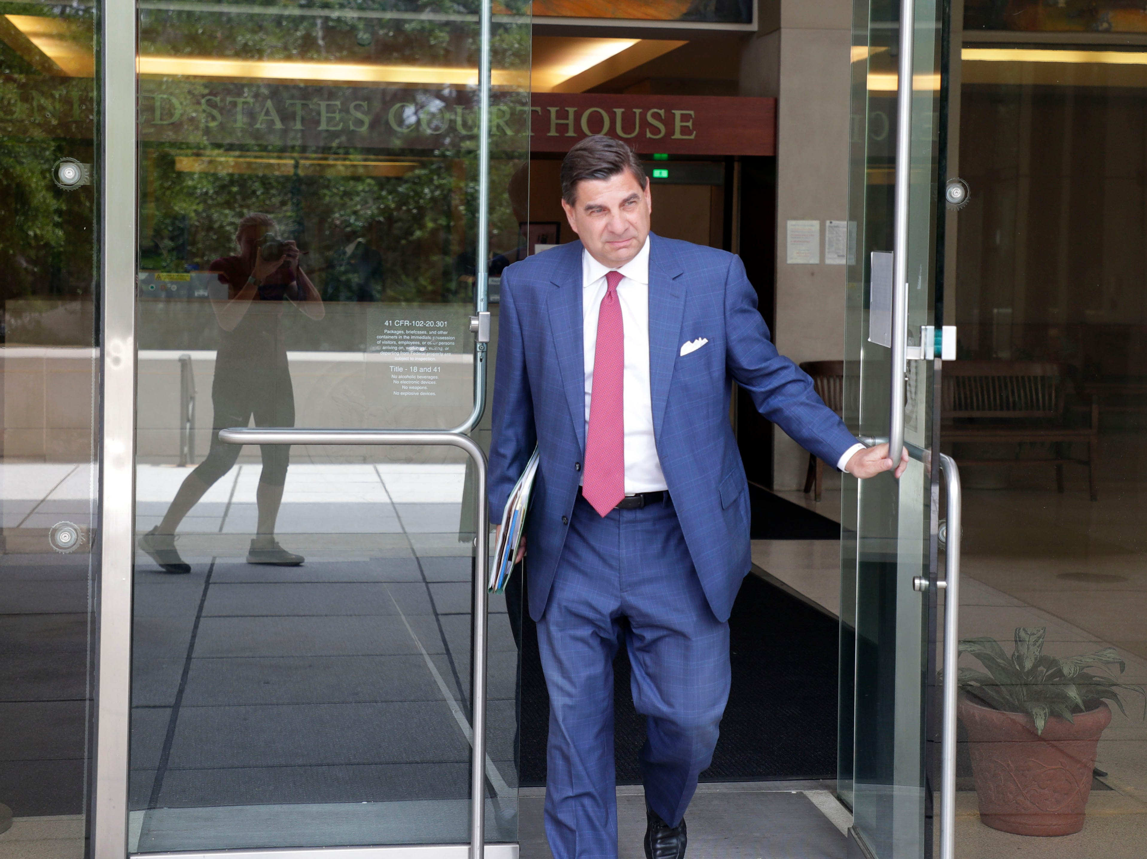 Tallahassee attorney Tim Jansen exits the Federal Courthouse in Tallahassee Thursday, May 9, 2019.