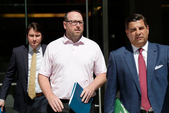 J.T. Burnette, a Tallahassee businessman, walks out of the Federal Courthouse after he was indicted in the FBI's long-running public corruption probe Thursday, May 9, 2019. Burnette, center, leaves with defense attorneys Adam Komisar, left. and  Tim Jansen.