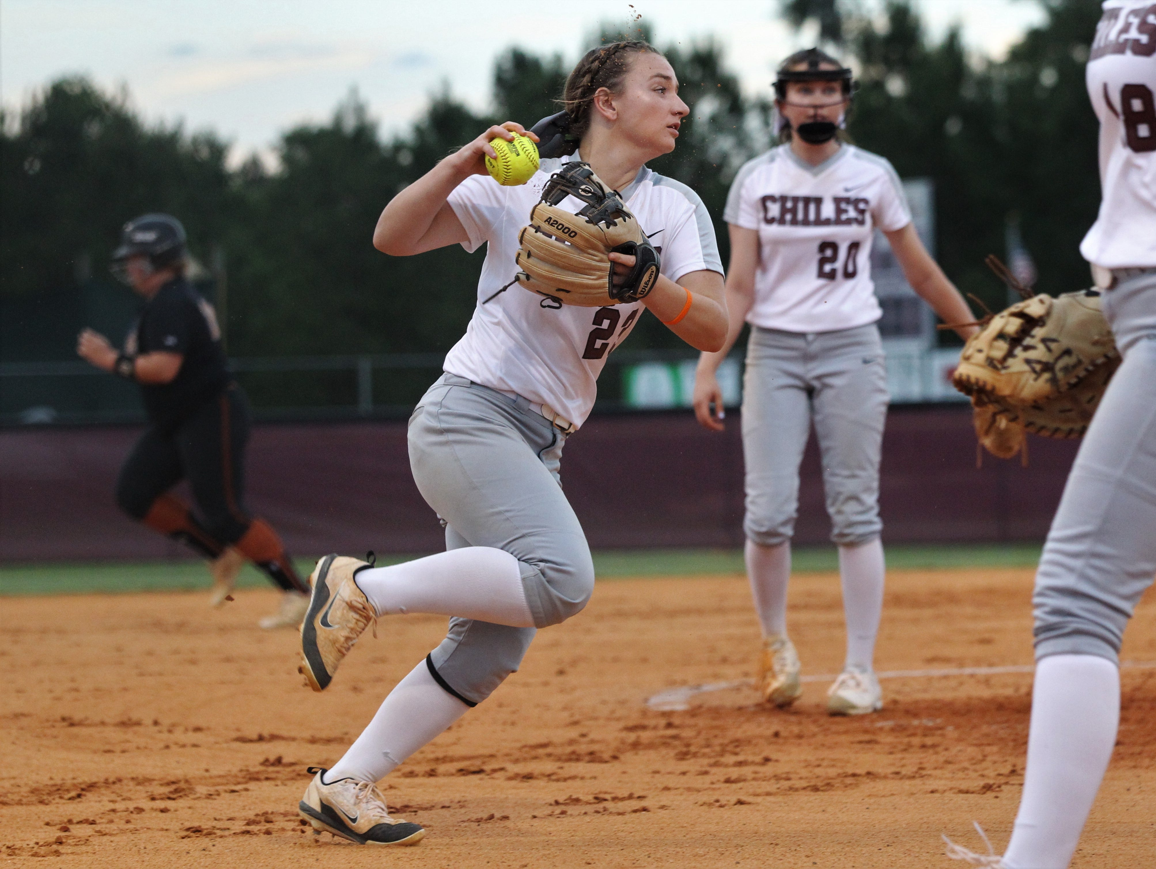 Chiles third baseman Sierra Jevyak fields a bunt on the run as the Timberwolves beat Atlantic Coast 6-4 during a Region 1-8A quarterfinal softball game on Wednesday, May 8, 2019.